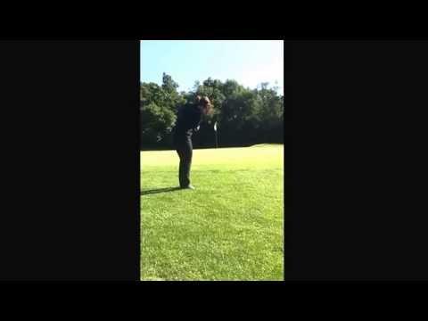 Jennifer using the golf training aid the Straight Arm to practice.     Straightarm.net