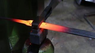 Forging a damascus sword.