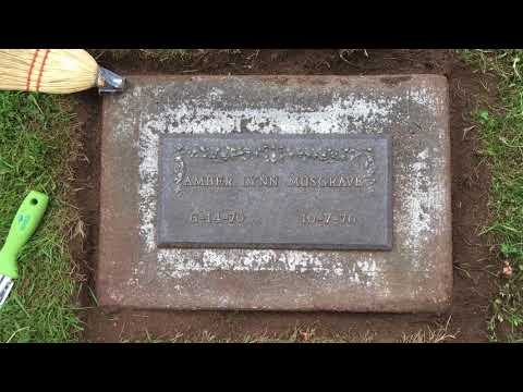 Cleaning A Bronze Grave Marker In The Kirkland, WA, Cemetery