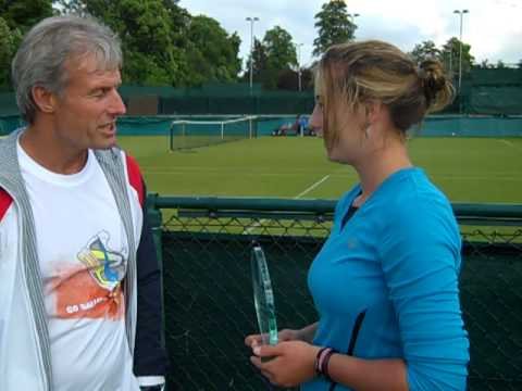 Eleanor Dean receives the AEGON Junior Player of the Month award for May from Nigel Sears