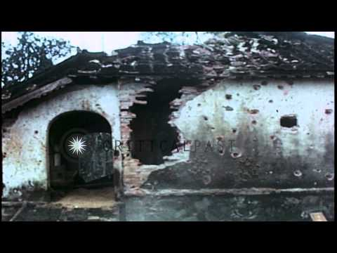 United States Army soldiers knock down cement walls of  building damaged by shell...HD Stock Footage