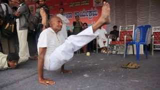 Indian Yoga performed by 80 year old of ashtanga asanas
