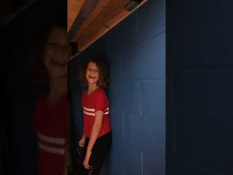 Going under the bleachers at my sisters volleyball game with my sister and my friend! WE  GOT CAUGHT |