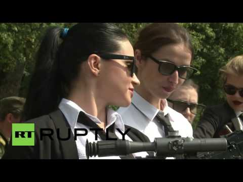 Russia: Shirts, ties, and guns! Young profnls hit military assault course to fight office boredom