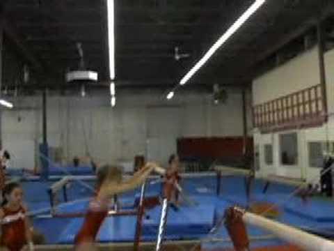 gymnastics - cast on low bar, jump to high