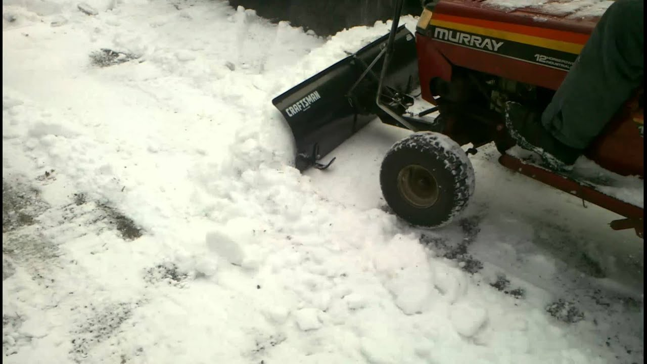 Lawn Tractor Plowing Snow