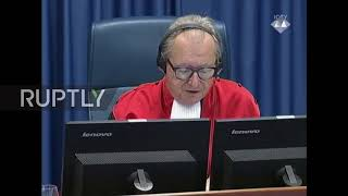 Netherlands: Full courtroom drama as war criminal drinks poison in dock