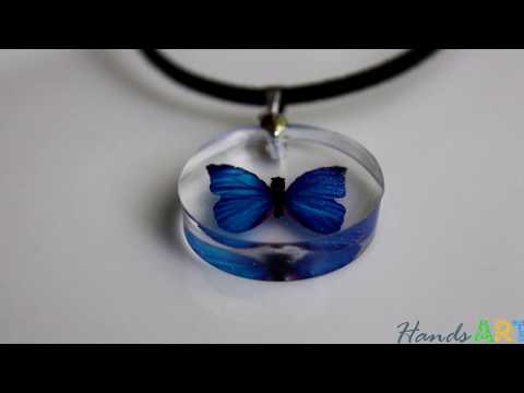 Handmade necklace with epoxy resin and butterfly
