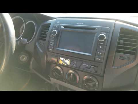 How to Remove Radio / Navigation / CD Player from Toyota Tacoma 2013 for Repair.