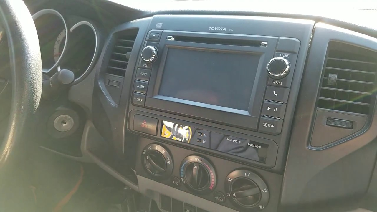 How to Remove Radio / Navigation / CD Player from Toyota Tacoma 2013 for  Repair