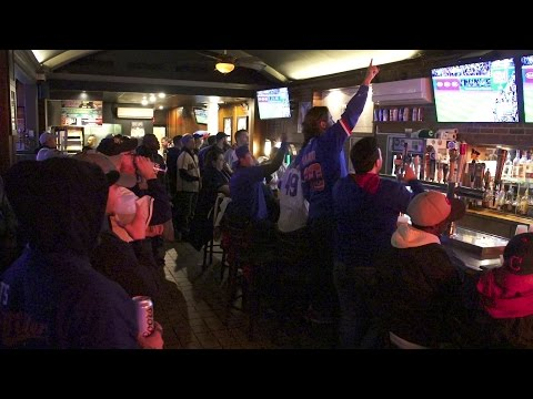 Chicago Cubs fans steal the thunder in downtown Cleveland bars as they take Game 2 over the Indians