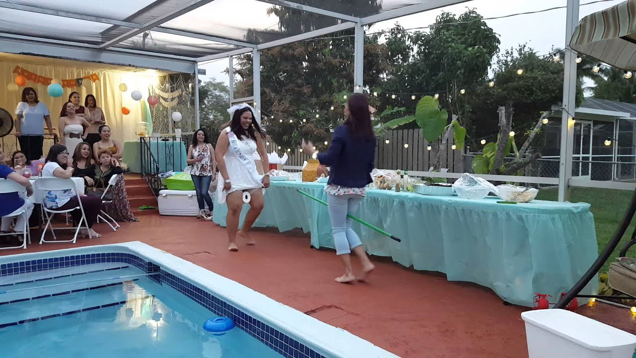 broom and toilet paper bridal shower game