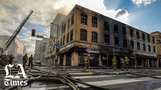 Smoking supplies explode as downtown L.A. building erupts in flames