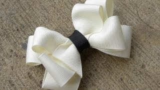 Repeat youtube video HOW TO: Make an Eight Loop Boutique Bow Tutorial by Just Add A Bow