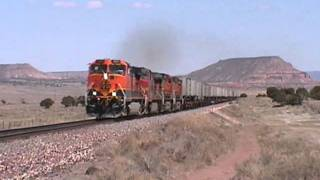 BNSF Z-train roars past at 70 mph, but trailers get a bumpy ride. Prewitt, NM. 4/24/2001