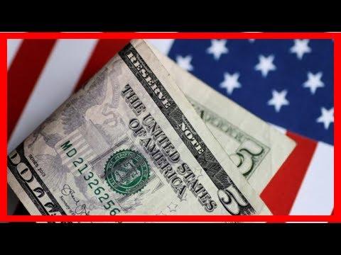 Breaking News | Dollar holds slim loss as home resales slump
