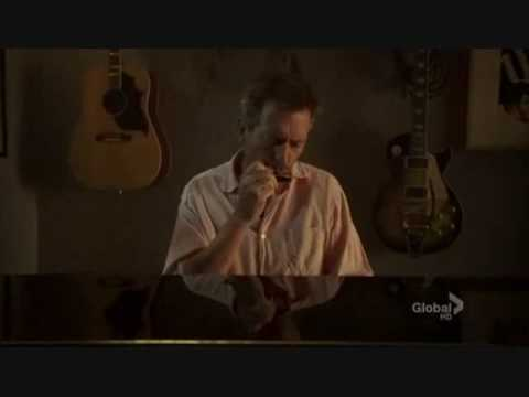 Dr. House playing harmonica
