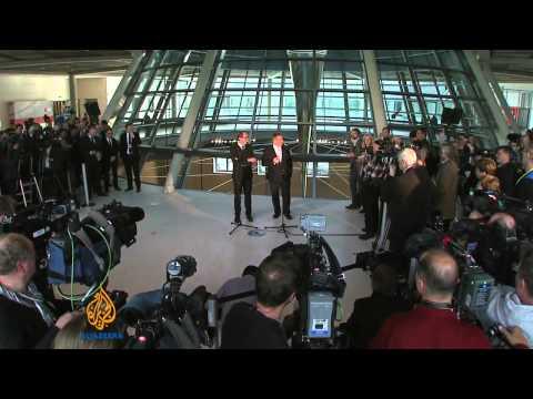 Merkel, rivals to continue coalition talks