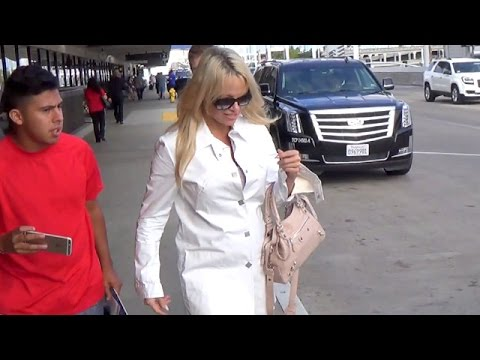 Pamela Anderson In All White Fashion Faux Pas At LAX thumbnail