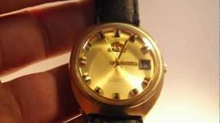35ca57b0682 Orient automático dourado pulseira de couro ...