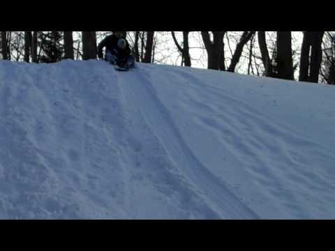 Justin snow sledding