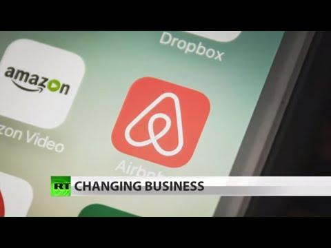 RT America: How Airbnb is defying capitalism & Milton Friedman