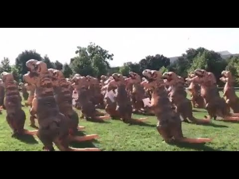 T-Rex Suit Protesters March on Washington Over Budget Cuts