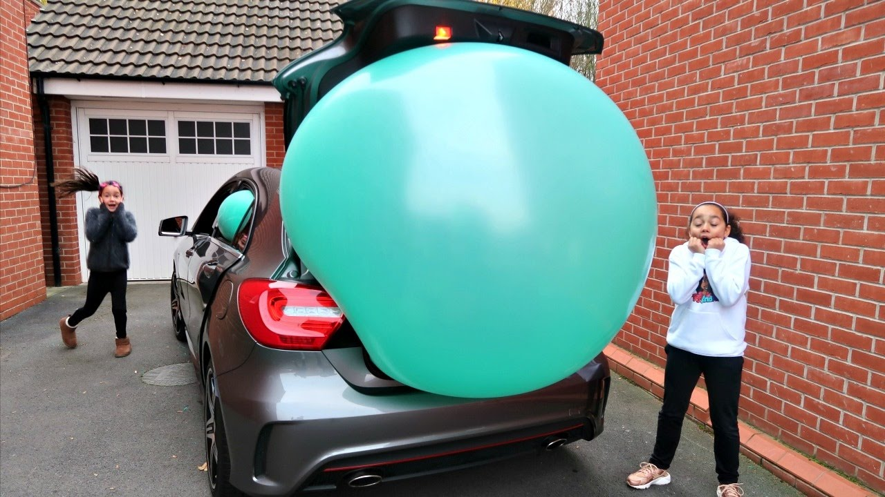 Image result for huge balloon on a car
