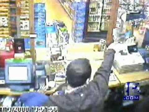 Surveillance Video Captures Robber, Clerk Shootout