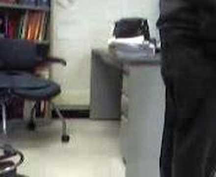 Kid Under Teachers Desk