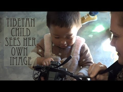 Tibetan child sees her own image / Too Cute