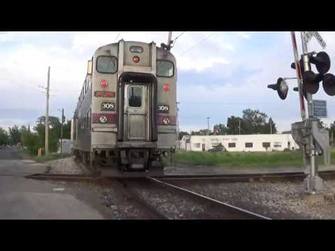A Couple of Trains Street Running in Michigan City IN Including Gallery Bi-Level Coaches