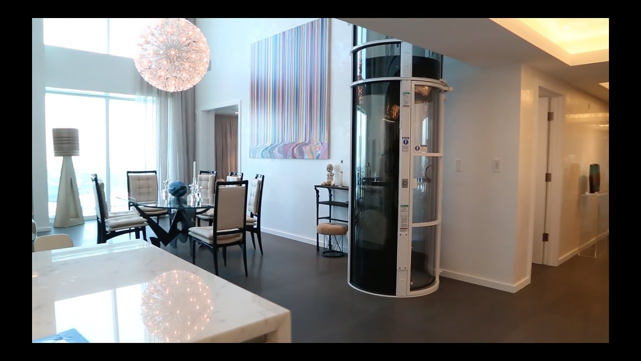 Luxury home elevators powered by air pneumatic vacuum for Luxury homes with elevators