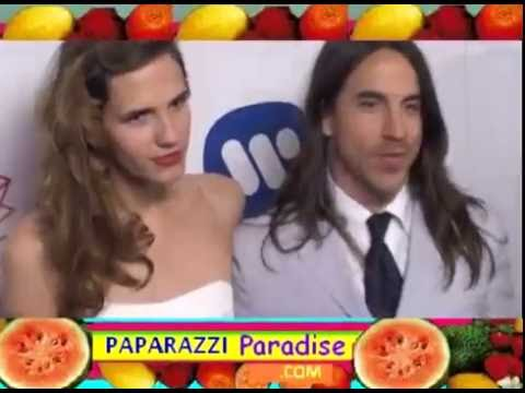 ANTHONY KIEDIS kisses girlfriend HEATHER CHRISTIE at Warner Music Group Grammy Party in L.A.