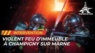 Les pompiers de Paris luttent plusieurs heures contre un violent feu de façade d'immeuble.