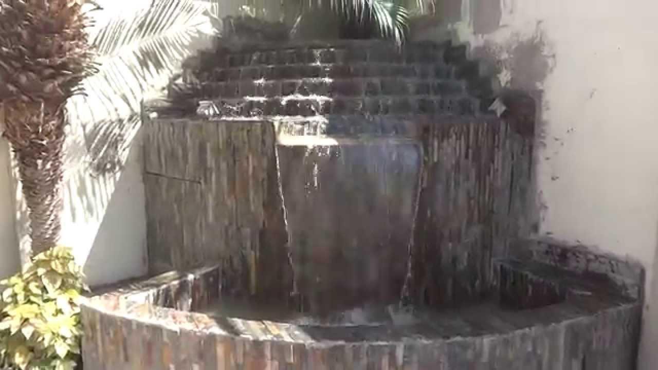 Cascada de rebose combinada con manto esquinera con for Cascadas para patios