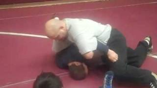 Arm Bar to a pin.  Wrestling technique.