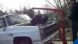 Removal of a 350 and transmission from a 1986 Chevy C10.