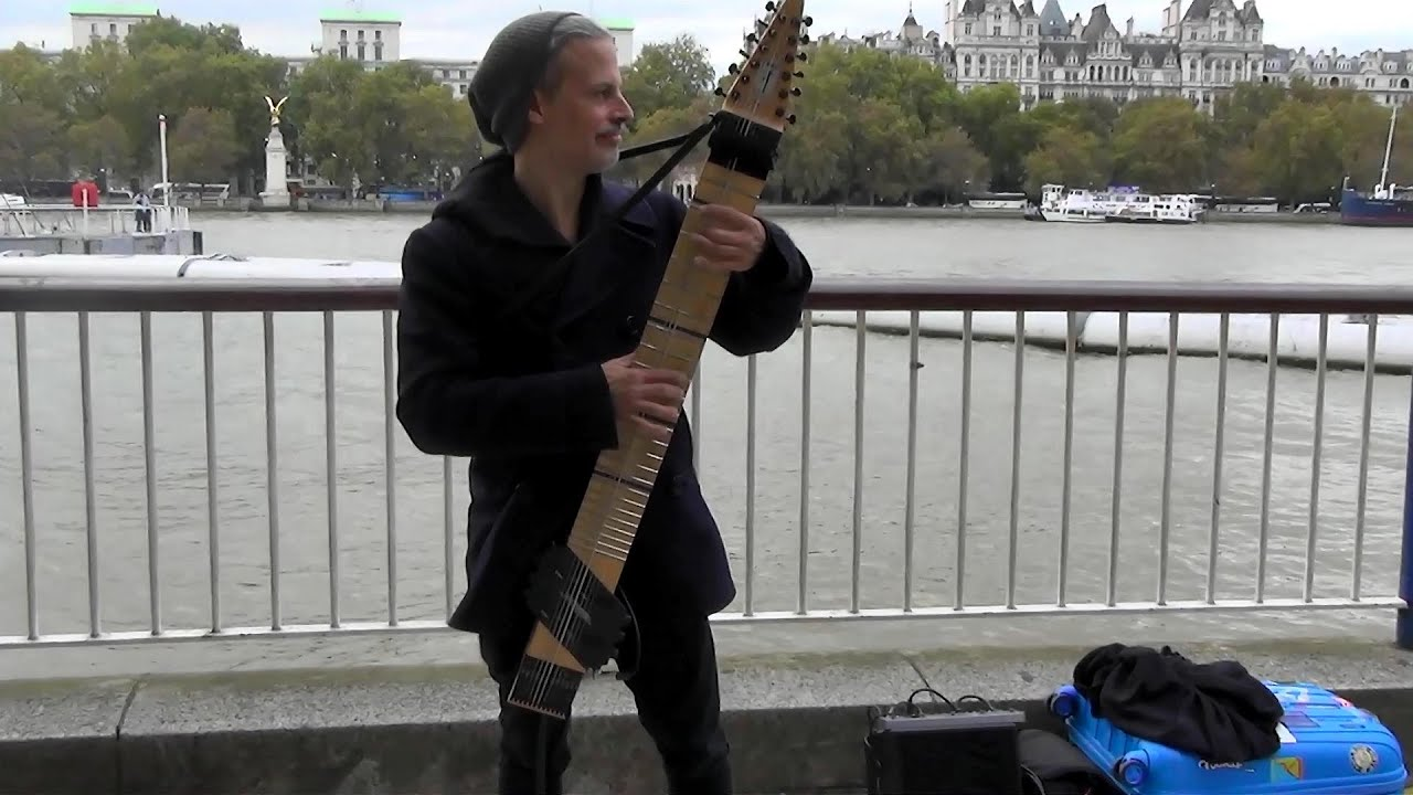 musician playing the chapman stick, 12-string instrument, in