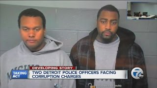 Two Detroit police officers charged