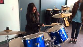 Jenny playing the drums to Tequila Sunrise (Emblem Three)