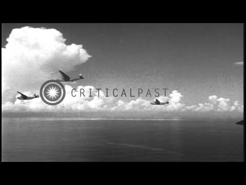 Formation of Martin PBM Mariner aircraft drop depth bombs during an aerial patrol...HD Stock Footage