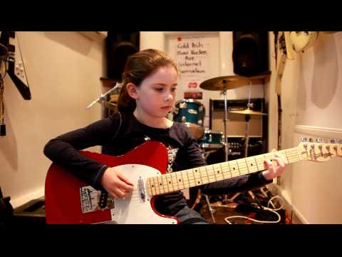9 year old Lucy's Burn Baby Burn by Ash cover on guitar.