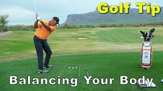 GOLF TIP - LEARN TO BALANCE YOUR BODY