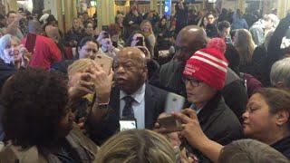 Cheering crowds swarm Rep. John Lewis at DC airport