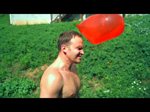 GIANT WATER BALLOON  In The Face at 10,000 fps - Slow Mo Lab (Balloon Face Pop)