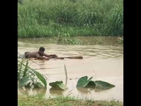 Man floating in caroni  River