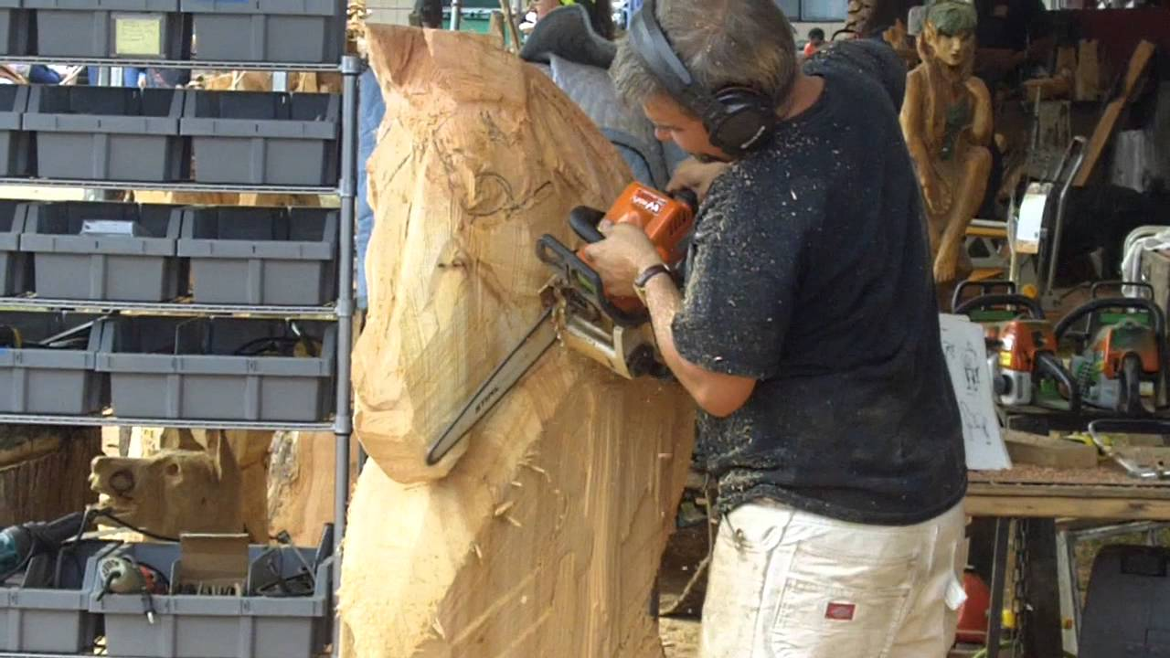 Chainsaw wood carving artist a horse head evergreen