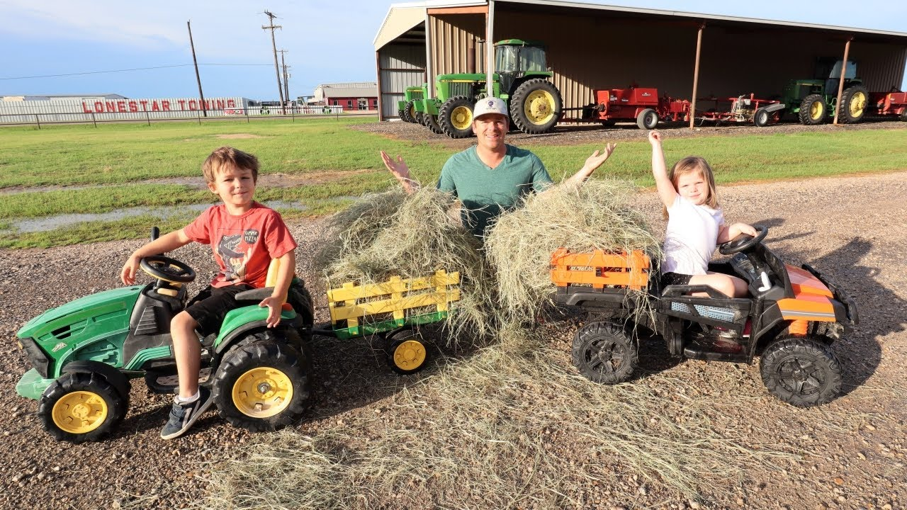 Using tractors to move hay before big storm | Tractors for kids working on the farm