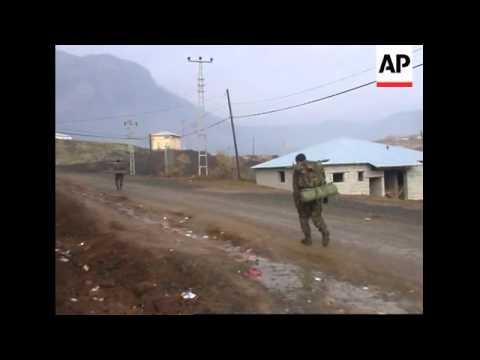 Soldiers on foot patrol, truck carrying an APC in border area between Turkey/NIraq